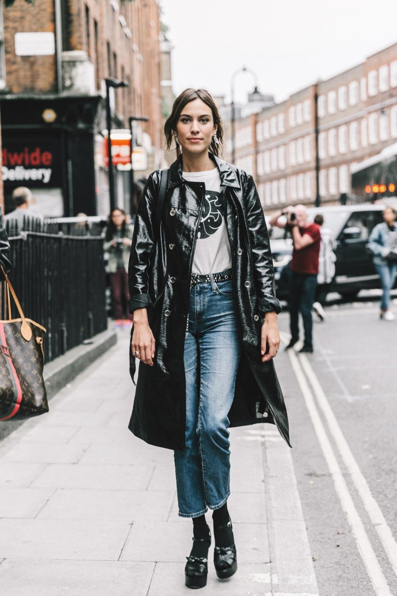Street style shot of Alexa Chung in patent black trench coat jacket
