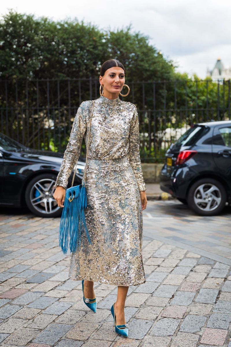 Woman in a gold long sleeve sequin dress