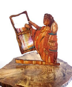 wooden sculpture of a person playing a hand held string instrument