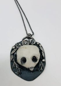 A necklace with a round skull pendant