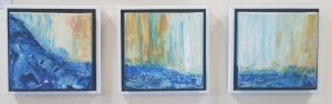 A set of 3 abstract paintings with blue and orange hues