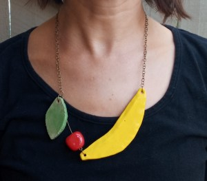 A necklace with a banana and other fruits