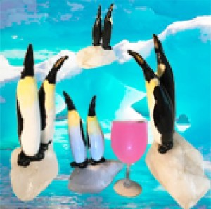 Gourd penguins standing around a glass