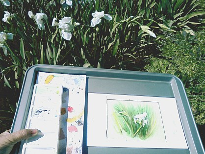 Painting tray with the lilies behind.
