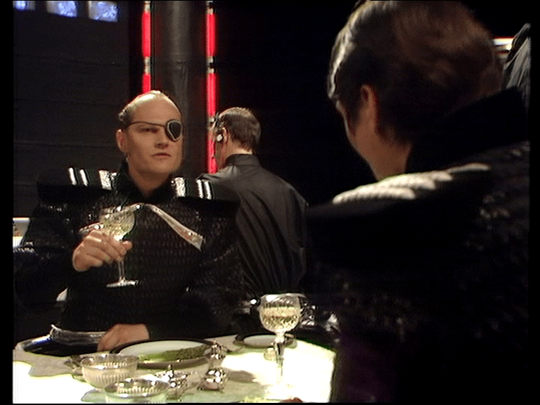 Eye patch Federation officer drinks wine over dinner