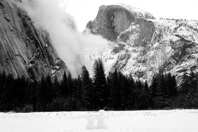 Snowmen looking at Half Dome in Yosemite National Park   Marsha J Black