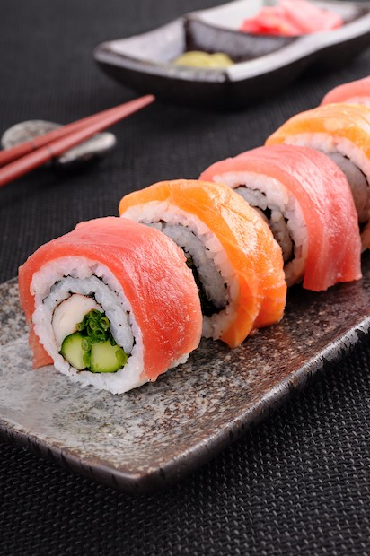Salmon & tuna sushi roll on a plate