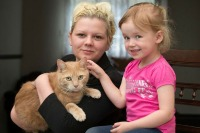 Mum, Chelsea-Ann with daughter and family cat Chesney