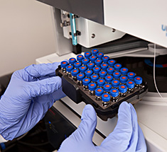 vials being tested with lab equipment