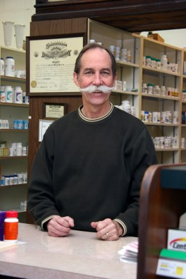 On most days, you'll see Nick Harrel III, a third-generation pharmacist who owns the store, behind the counter filling prescriptions for his longtime patients.