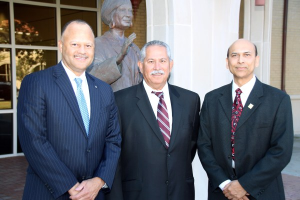 From left to right, Roy Armstrong, market pharmacy director from Houston, and Oscar L. Ortiz, R.Ph., pharmacy supervisor in Corpus Christi, give a $10,000 grant to support increasing diversity among professional student pharmacists to Indra K. Reddy, Ph.D., professor and founding dean of the Texas A&M Health Science Center Irma Lerma Rangel College of Pharmacy.