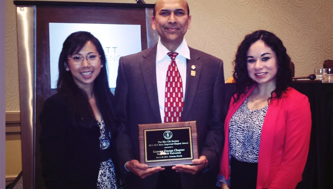 Indra K. Reddy (center), Ph.D., professor and founding dean of the Texas A&M Rangel College of Pharmacy, joins Quyen Dau (right) of Sugar Land, Texas, third-year professional student pharmacist and Rho Chi Gamma Omega Chapter president, and Annie Lozano (left) of Premont, Texas, third-year professional student pharmacist and Rho Chi secretary, as they received the Most Improved Chapter Award at the American Pharmacists Association Annual Meeting in Orlando, Fla.