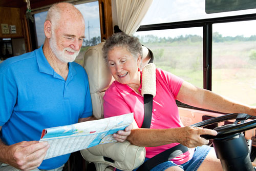 photo of couple looking at a map in an RV