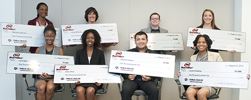 students with scholarship checks