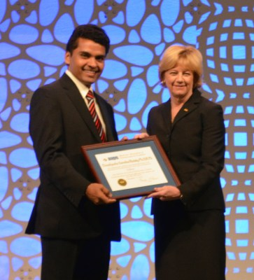 Photo of Dr. Reddy accepting an award from Dr. Morris.