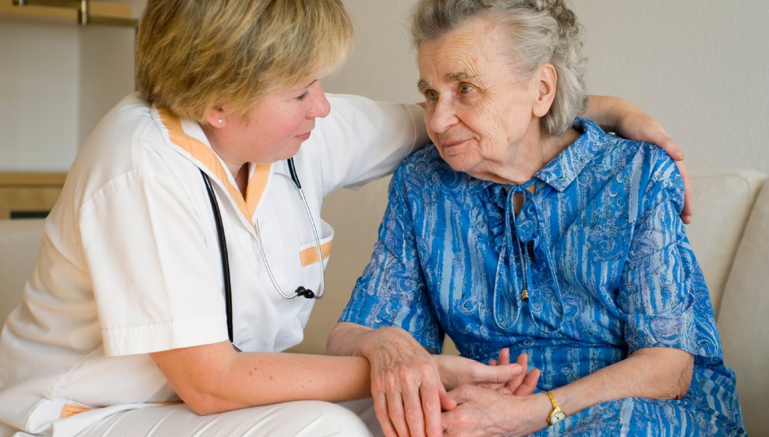 Geriatric nurse caring for an older woman