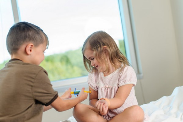 Children playing with doctor set.