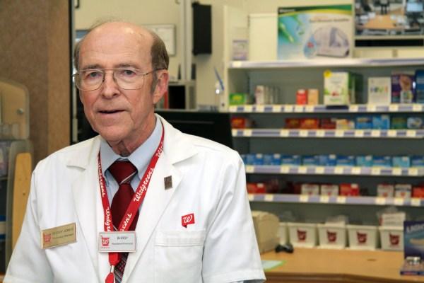 Pharmacist Buddy Jones prepares medication for patients