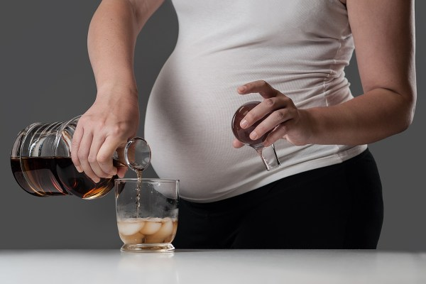 Pregnant woman with alcoholic drink.