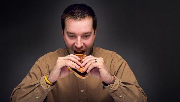 Man eating unhealthy foods
