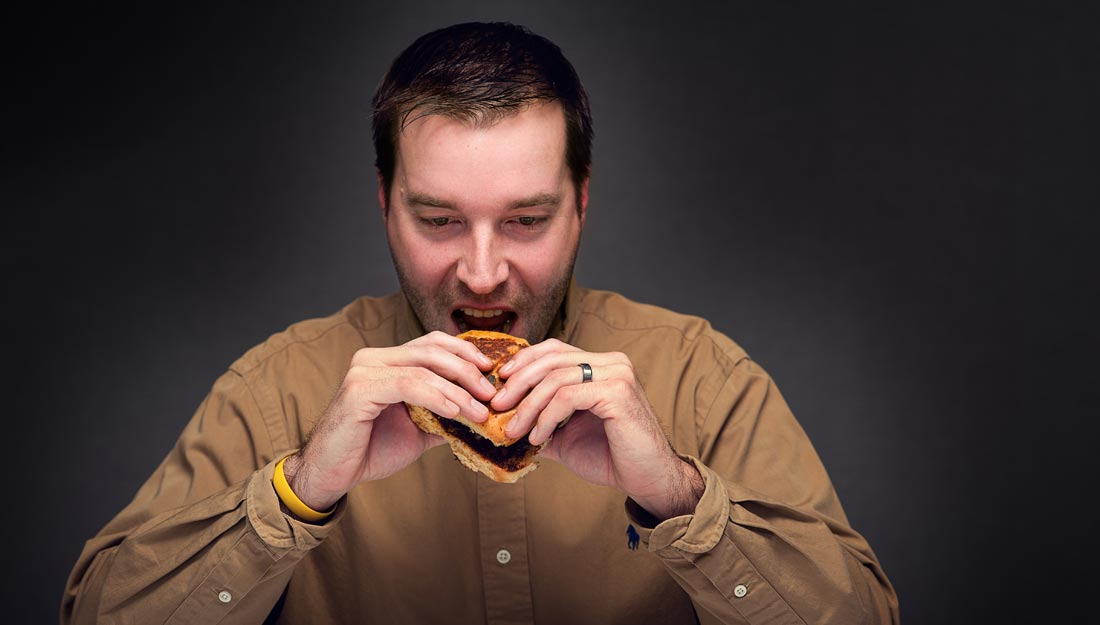 Man eating unhealthy foods