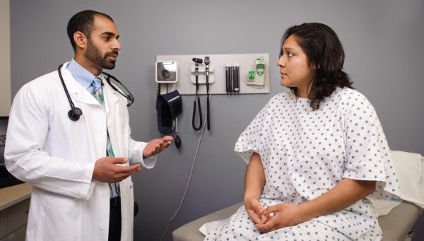 Doctor checking female patient