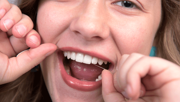 Female flossing