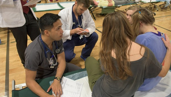 Interprofessional students treat a patient