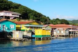 Houses built on stilts along the coast of Roatan, Honduras