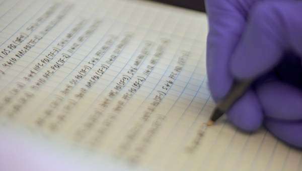 Hand writing in lab notebook
