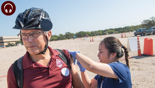 Aggie getting flu vaccine from nursing student