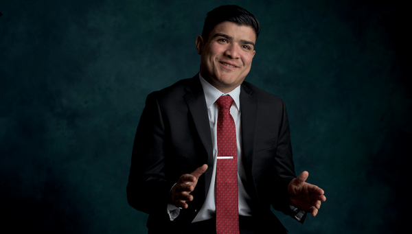 Luis Seija, leader of the Aggie Health Project, speaks towards the camera while gesturing with his hands.