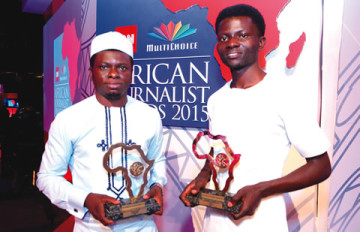 L-R: Umukoro and Asu with their awards  (source: The Punch)