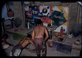Fela worshipping at in self-made pulpit in the then Afrika shrine