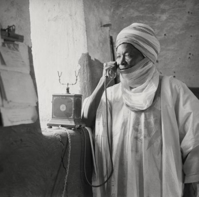 Northern Chief talking on the telephone Kano, Northern Nigeria, 1937