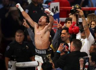 Pacquiao celebrates his victory over Vargas at the Thomas & Mack Center in Las Vegas