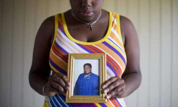Najee Washington holds a photo of her grandmother Ethel Lance one of the nine people killed in the shooting at Emanuel AME church Photograph David Goldman - AP