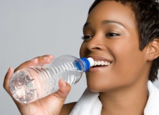 Black woman drinking water
