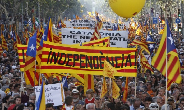 people-take-streets-banner-reading-independence-during-protest-greater-autonomy-catalonia-referendum