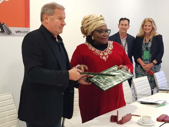 VMware Maurizio Carli exchanges signed MOU with African Union Prof. Sarah Agbor
