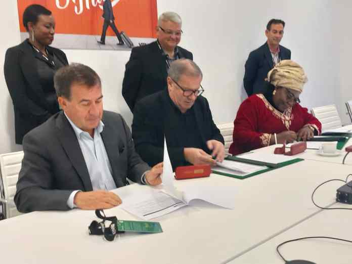 VMware Maurizio Carli signing the MOU with African Union Prof. Sarah Agbor