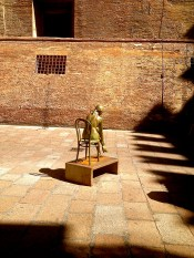 Just outside Piazza Maggiore. Statues of women are placed around the small square.