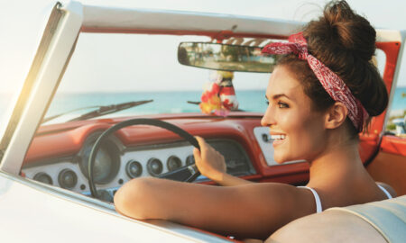 AdobeStock-woman-classic-car-bandana-hair-up, How to Wear a Bandana and Still Look Sexy AF
