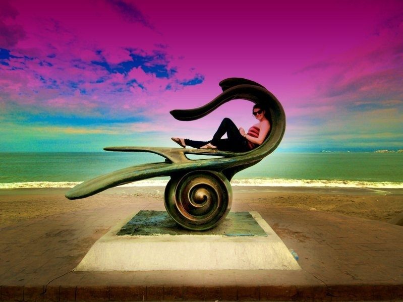 In this statue on the beach in Puerto Vallarto, Mexico.