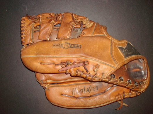 Only 1 gross lefty glove in gym glass