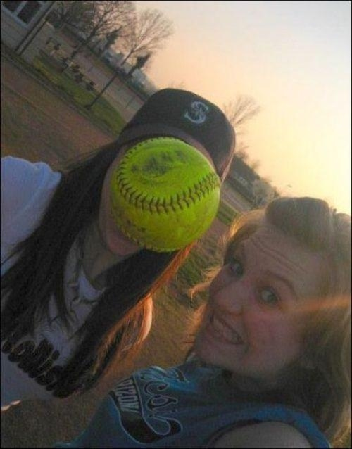 The perfectly timed softball to the face photo: