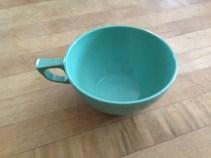 Plastic cup. Trash.