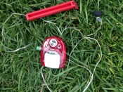 A portable AM/FM radio WITH flashlight AND a chip clip. TRASH.