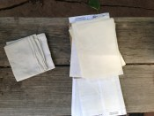Handkerchief and the backings to sticky labels. TRASH.