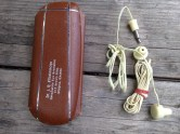 Vintage ear buds and an old eyeglass case.